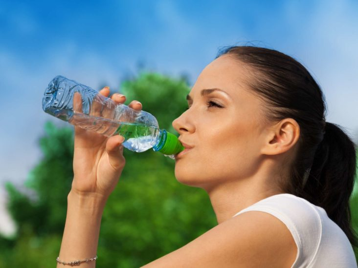 Womens drinking water from bottle